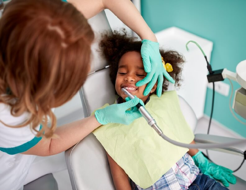 Young African American Girl At The Pediatric Dentist