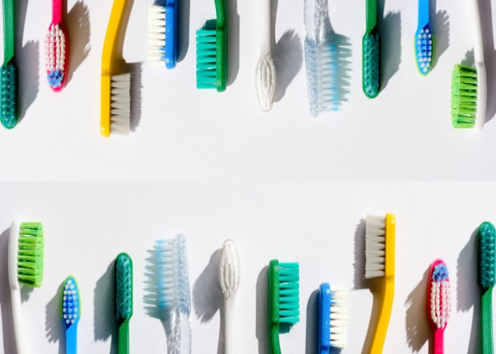 Two rows of colorful toothbrushes